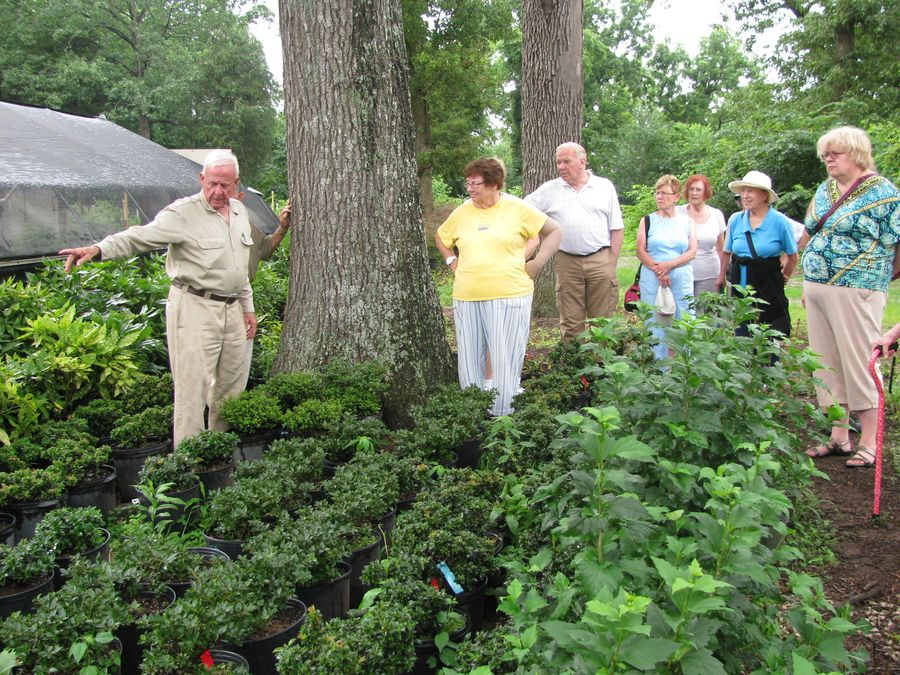 Don telling the group more about the specialty plants he grows