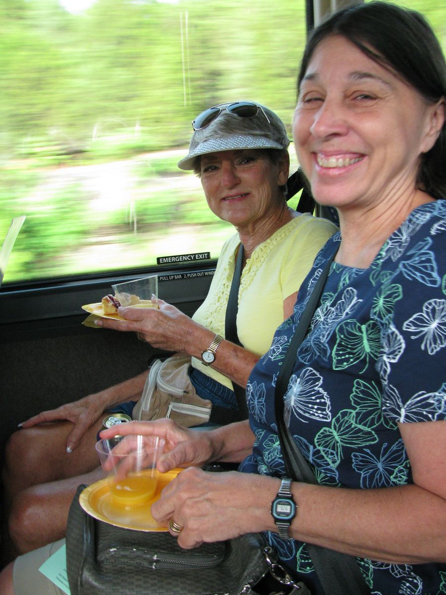 Mollie Howell and Jo Anne Martinez enjoying breakfast on the bus
