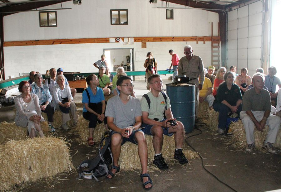 Tour group in the barn enjoying Don's slide show of plant-hunting in Japan