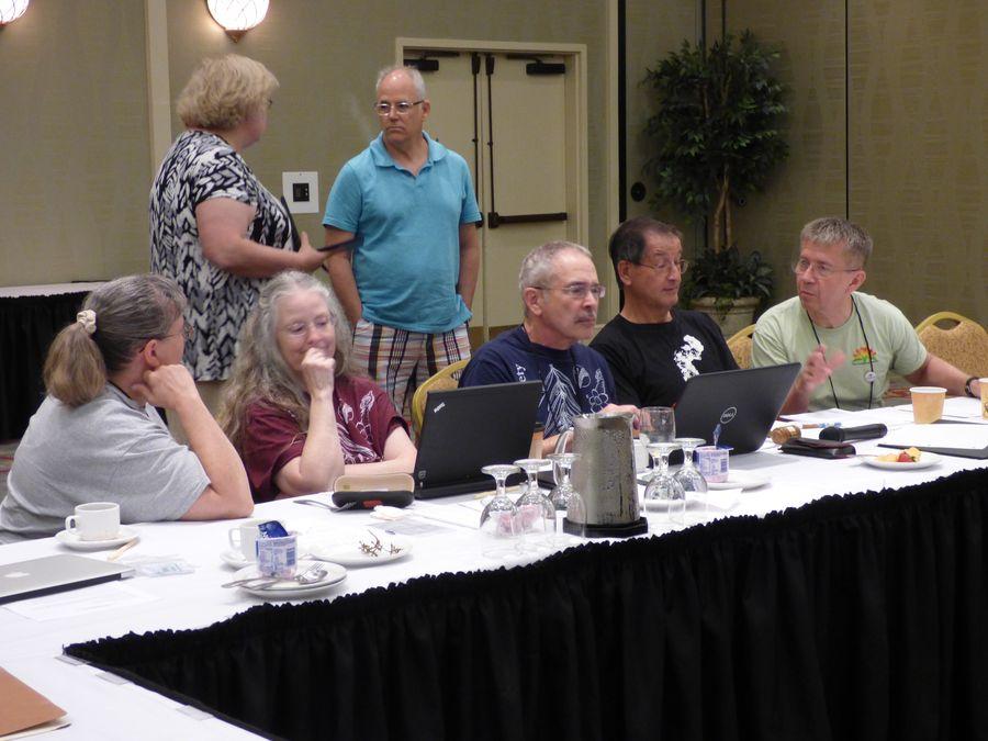 Board members chatting during a break