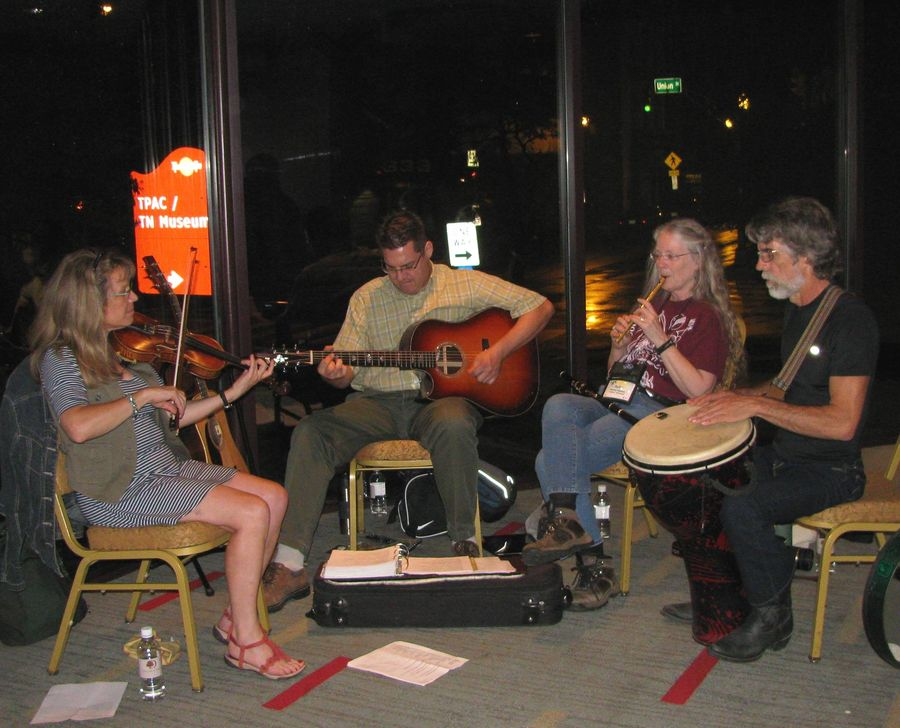 Julie Mavity-Hudson and her husband Eddy (right) with other members of the Fiddle and Pick Caeli Band (Gretchen Priest May and Tony Novak)