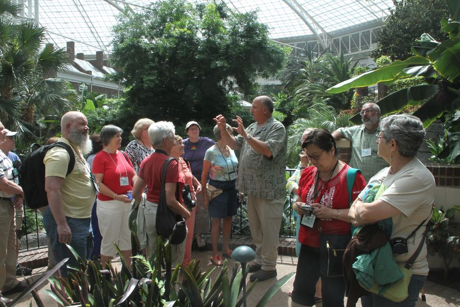 Tour group and guide out in one of the conservatories