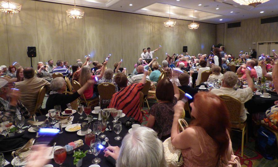 Attendees waving their light sticks as Wen Fang sings