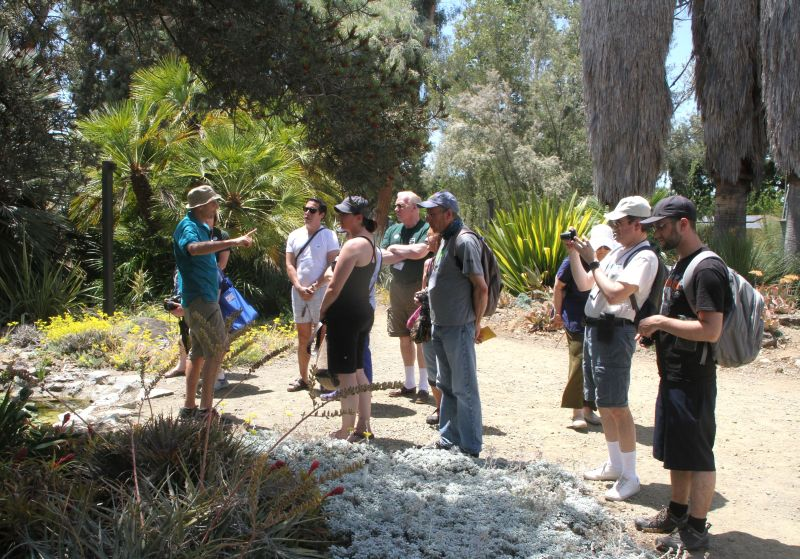 Tour guide discussing the garden