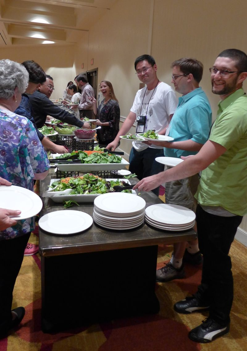 Attendees in the buffet line