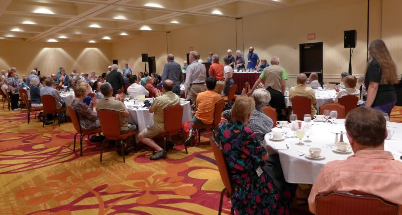 Convention attendees standing who have received Awards of Appreciation over the years