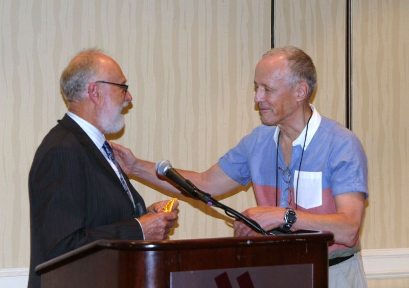 Paul Lee presenting Bill Price with his awards, including Sweepstakes in Horticulture