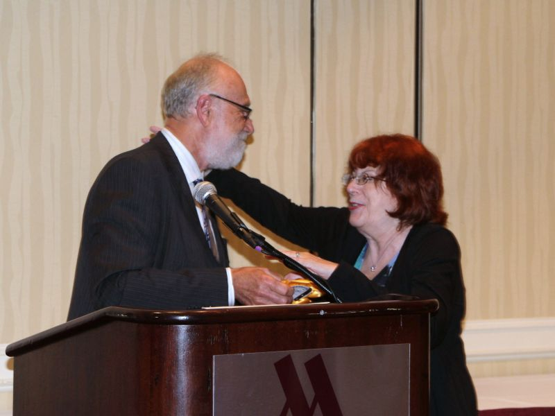 Awards Chair Paul Lee presenting Laura Buckner with Sweepstakes in Artistic