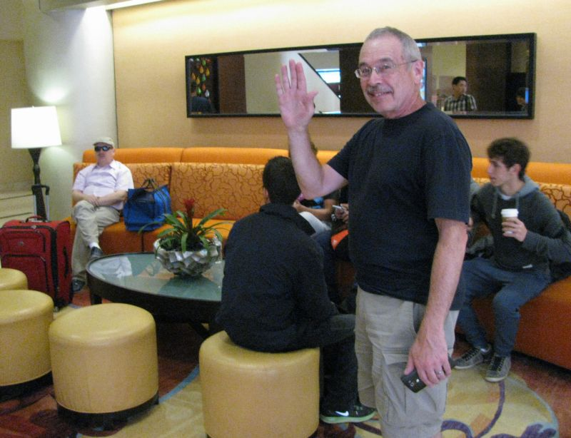 Paul Susi waving goodbye till next year when friends meet again
