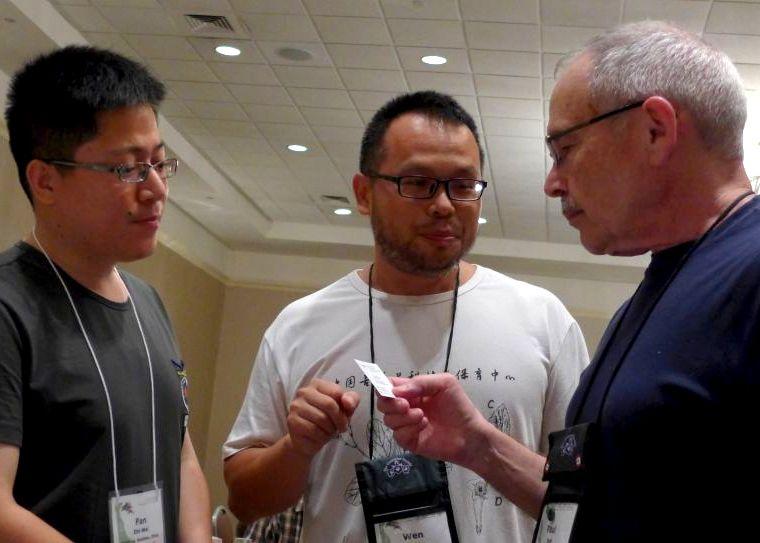 Wen Fang (center) introduces Fan Zhi-Wei to Paul Susi