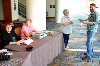 Sunday opening of Registration with Sylvia Svitak, Kathy Coleman, Mary Helen Maran (Registrar), Brandon Erikson