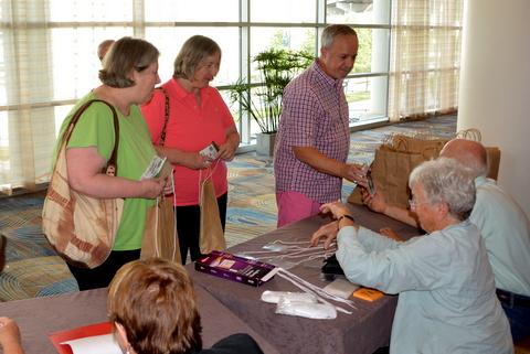 Phyllis and Pat Savage and Jim Roberts registering