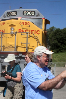 Joan Wood, Mary Schaeffer and Mel Grice at the top of the hill with the Union Pacific train engine