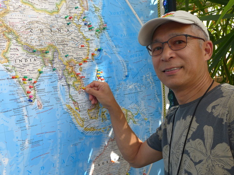 Hung Nguyen putting a marker at his native Vietnam home on the world map of garden visitors