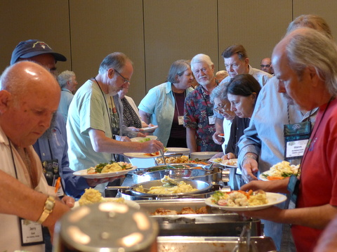 Filling plates at the Opening Dinner Buffet