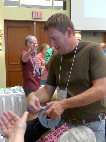 Tom Bruning handing out door prize tickets at GHA