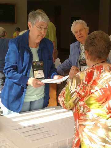Sally Robinson and M J Tyler assist with Entries check in on Thursday morning