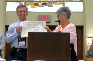 Elizabeth Varley presenting Stephen Maciejewski with an Award of Appreciation