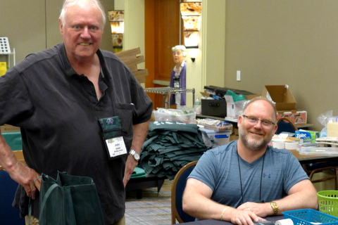 Sales check-out volunteers John Daniel and Winston Goretsky (among many)