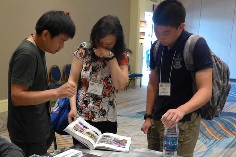 Qui Zhi-Jing talks with Li Zhang and Jonny Yue as he signs his book on petrocosmeas