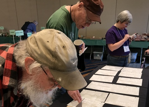 David Pierce, Jon Dixon, and Sarah Ingalls looking to buy at the Seed Fund table