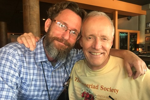 Brandon Erikson with Bill Price wearing the 2017 Society tee shirt designed by Carol Ann Bonner