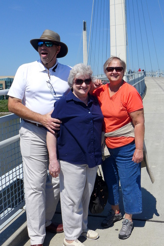 One more walk over the Bob Kerry pedestrian bridge for the registration team: Jay Sespico, Mary Helen Maran, Kathy Coleman … they'll greet you again next year in Massachusetts