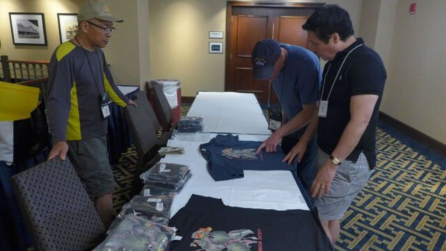Back at the hotel – Hung Nguyen displaying the 2018 tee-shirts