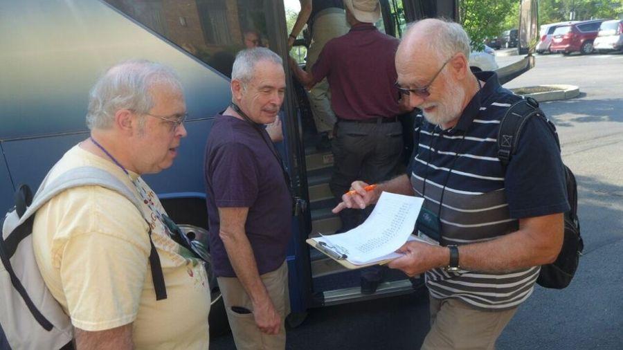 Volunteer Paul Lee checking in Paul Susi and Mel Grice